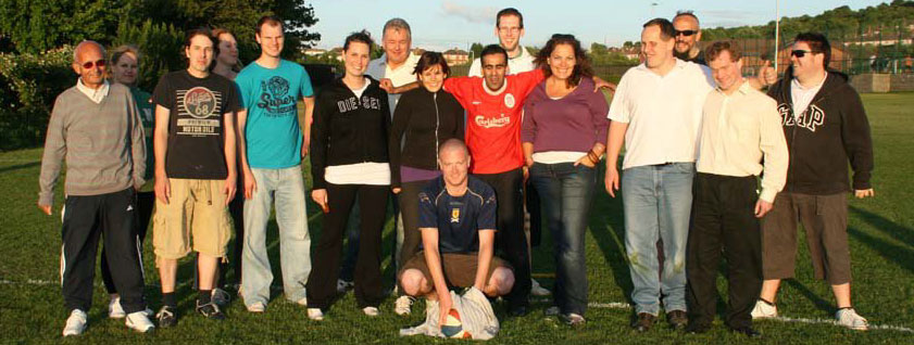 Image of all the staff together in the sun, wearing their sports kit having played blind cricket.