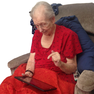A photo of Barbara using GuideReader Tablet