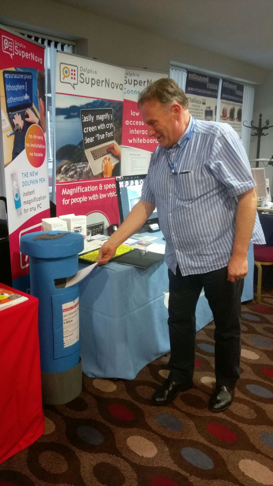 Event attendee posting his prize draw entry into the Dolphin postbox