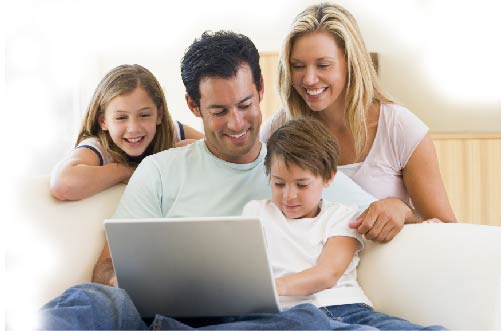 A family sat around laptop