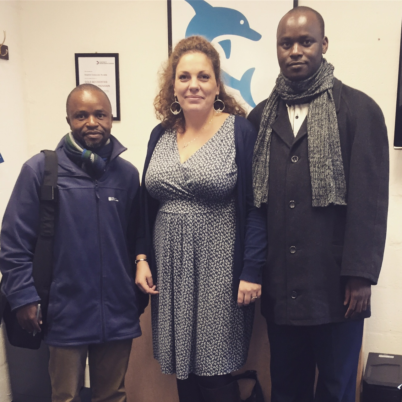 Dolphin Marketing Director Hazel Shaw, pictured with Deputy Head Mr Joram Kulwa  (right) and Head of the VI unit Mr Ernest Mbilu (left)