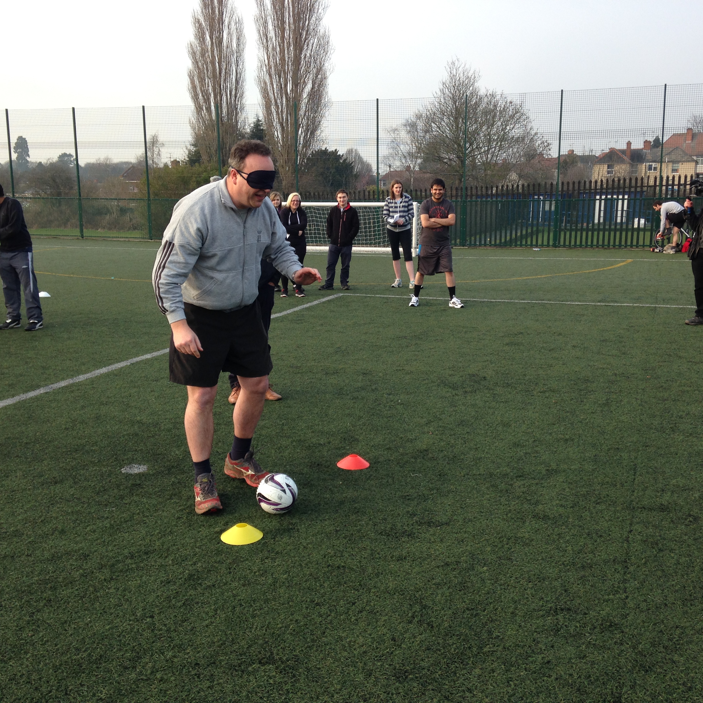 Richard wearing a blindfold and preparing to take a penalty