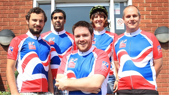 Dolphin cycling team wearing Blind Veterans jerseys