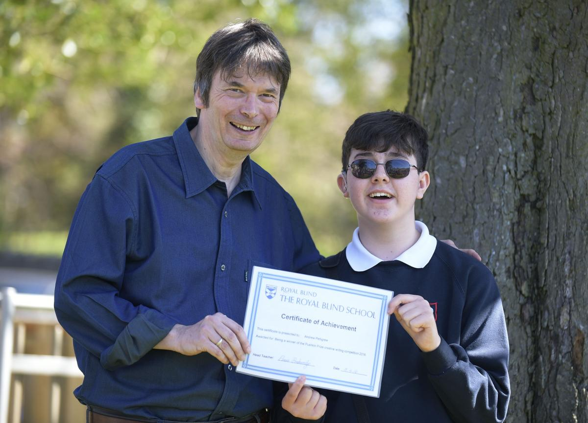 Seeing Ear competition winner Andrew Pettigrew with Scottish writer Ian Rankin
