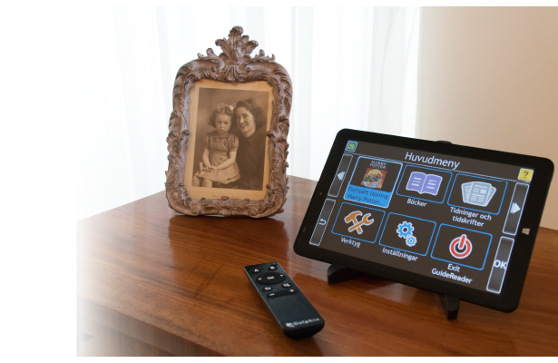 GuideReader Tablet on a sideboard with the Dolphin remote.