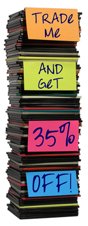 A pile of floppy disks with post-its that read Trade-me and get 35% off